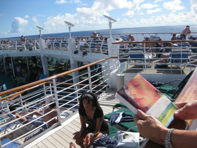 "CRUISE SHIP SUNBATHER READING ""WIVES"""